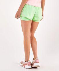 Shorts-Alto-Giro-Sobreposto-Bahamas-Bicolor-VERDE-JOY-costas